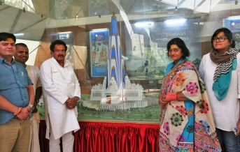 Prof. Baghel views a model of the upcoming skyscraper temple