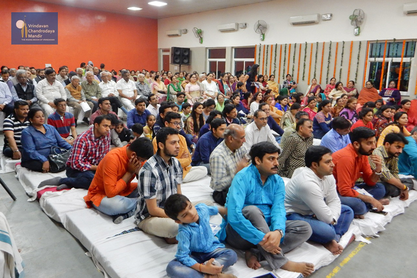 Devotees and visitors attending Kirtan