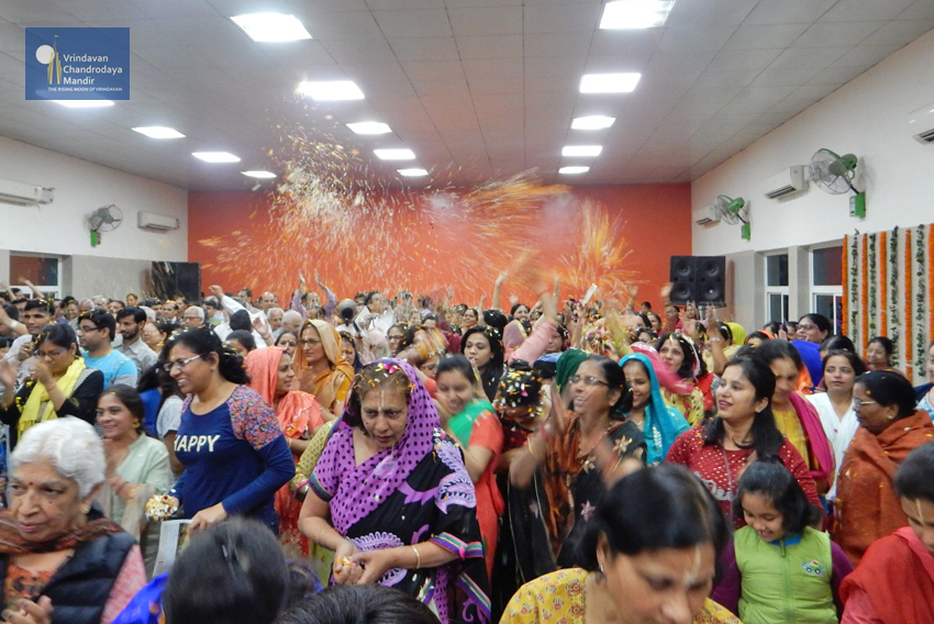 Devotees enjoying flower holi