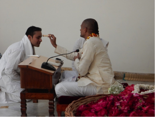 A Devotee Accepts Tilaka on the Forehead
