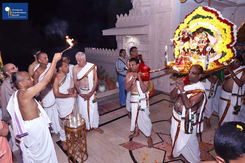 Deities offered arathi as They proceed for Boat Festival